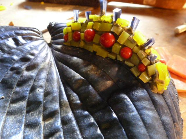 Mosaic Caterpillar on a concrete leaf